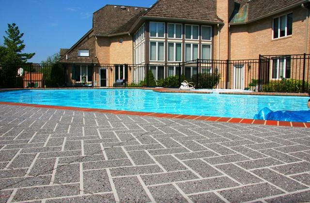 Herringbone Brick around a Concrete Pool Deck